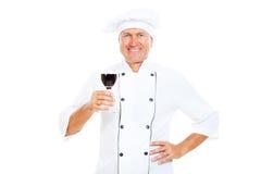 Het glas van de de chef-kokholding van Smiley wijn Royalty-vrije Stock Foto