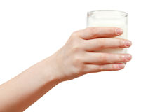 Het glas van de handholding geïsoleerde melk Stock Afbeeldingen