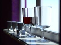 Het glas van de wijn door het venster Stock Foto's