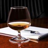 Het glas van het cognacglas cognac stock foto