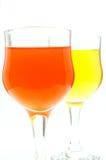 Het glas van het water met oranje en gele kleuren Royalty-vrije Stock Foto's