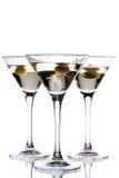 Het glas van martini met binnen olijf Royalty-vrije Stock Afbeeldingen
