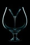 Het glas van martini op een zwarte Stock Foto