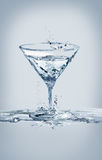 Het Glas van watermartini Stock Foto's