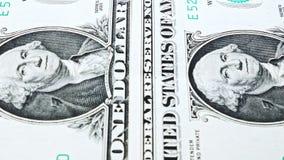 Het glijden video die van een nota van de één Amerikaanse dollarrekening, het portret van de V.S. President George Washington ton stock video