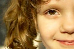 Het glimlachen gezicht van een kind Royalty-vrije Stock Foto's