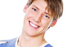 Het glimlachen gezicht van knappe tiener Stock Fotografie