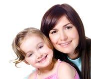 Het glimlachen gezichten van moeder met dochter Stock Foto's