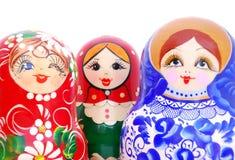 Het glimlachen gezichten van Russische poppen Stock Foto