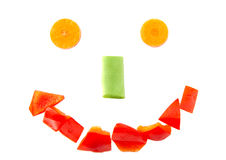 Het glimlachen gezichtsvorm met gehakte Spaanse peper wordt gevormd die Royalty-vrije Stock Foto