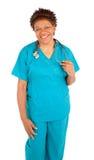 Het glimlachen het Afrikaanse Amerikaanse Stellen van de Verpleegster royalty-vrije stock afbeelding