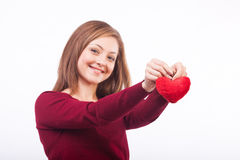 Het glimlachen het hartvorm van de vrouwenholding Stock Afbeelding