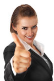 Het glimlachen het moderne bedrijfsvrouw beduimelt tonen omhoog Duitsland Royalty-vrije Stock Fotografie