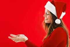 Het glimlachen het tonen van het Meisje van de Kerstman Stock Foto