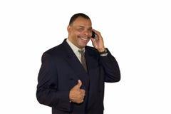 Het glimlachen hetAmerikaanse mens omhoog beduimelt stellen Stock Foto