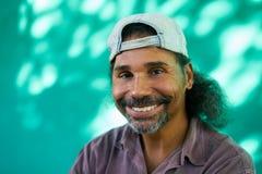 Het glimlachen Mensenportret van de Spaanse Mens met Sik het Lachen Stock Foto