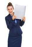 Het glimlachen onderneemsterbedrijfsdossier omhoog naast gezicht Stock Afbeelding