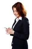 Het glimlachen smartphone van de onderneemsterholding royalty-vrije stock foto's