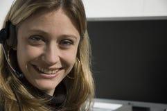 Het glimlachen telemarketer Stock Foto