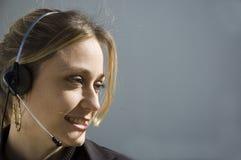 Het glimlachen telemarketer Stock Foto's