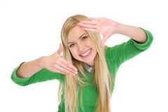 Het glimlachen tienerstudentenmeisje frame met handen stock afbeeldingen