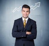 Het glimlachen van bedrijfskerel met grafiekpijl Royalty-vrije Stock Afbeeldingen