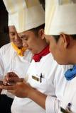 Het glimlachen van chef-koks royalty-vrije stock fotografie