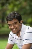 Het Glimlachen van de jonge Mens Stock Foto's