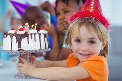 Het glimlachen van jonge geitjes bij een verjaardagspartij Stock Afbeeldingen