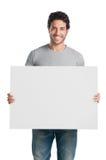 Het glimlachen van kerel met teken Royalty-vrije Stock Afbeeldingen