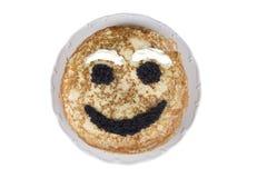Het glimlachen van pannekoek op een plaat Royalty-vrije Stock Afbeelding