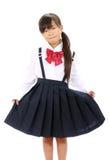 Het glimlachen van weinig Aziatisch schoolmeisje Royalty-vrije Stock Afbeeldingen