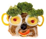 Het glimlachen voedselgezicht Stock Afbeeldingen