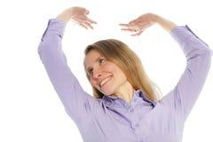 Het glimlachen vrouw het uitrekken zich Stock Afbeeldingen