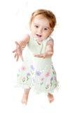 Het glimlachende Meisje dat van 2 Éénjarigen Bellen vangt Royalty-vrije Stock Afbeeldingen