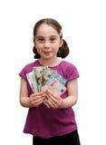 Het glimlachende meisje houdt bankbiljetten stock foto's