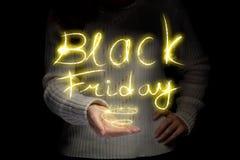 Het gloeien inschrijving Black Friday stock afbeelding