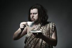 Het goede fokken Zoete croissant en een kop van koffie op de achtergrond Stock Afbeeldingen