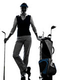 Het golfing silhouet van de vrouwengolfspeler Royalty-vrije Stock Foto's