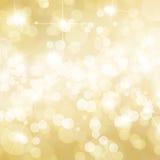 Het goud defocused lichtenachtergrond Stock Afbeeldingen
