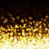 Het goud defocused lichtenachtergrond Royalty-vrije Stock Foto's