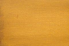 Het goud schilderde artistiek achtergrondtextuurpatroon royalty-vrije stock afbeeldingen