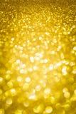 Het goud schittert bokeh abstracte achtergrond Stock Foto