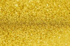 Het goud schittert bokeh abstracte lichte achtergrond Stock Foto
