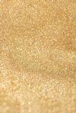 Het goud schittert textuurachtergrond, de achtergrond van de fonkelingsvakantie royalty-vrije stock afbeelding