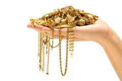 Het Goud van de Holding van de hand royalty-vrije stock afbeelding