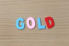 Het Goud van kleurrijke teksten Stock Fotografie
