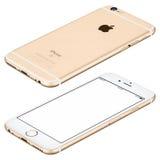 Het gouden Apple-iPhone6s model ligt op met de wijzers van de klok mee geroteerde oppervlakte Royalty-vrije Stock Foto