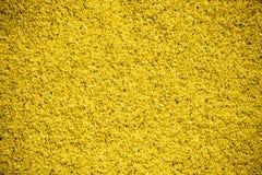 Het gouden close-up van de zandtextuur, helder contrast Royalty-vrije Stock Afbeelding
