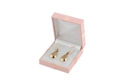 Het gouden earing van Jewelery royalty-vrije stock afbeeldingen